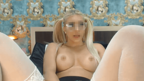 blonde girl with glasses masturbating in the bed